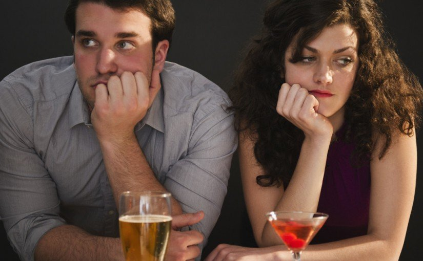 USA, New Jersey, Jersey City, Bored couple sitting at bar counter